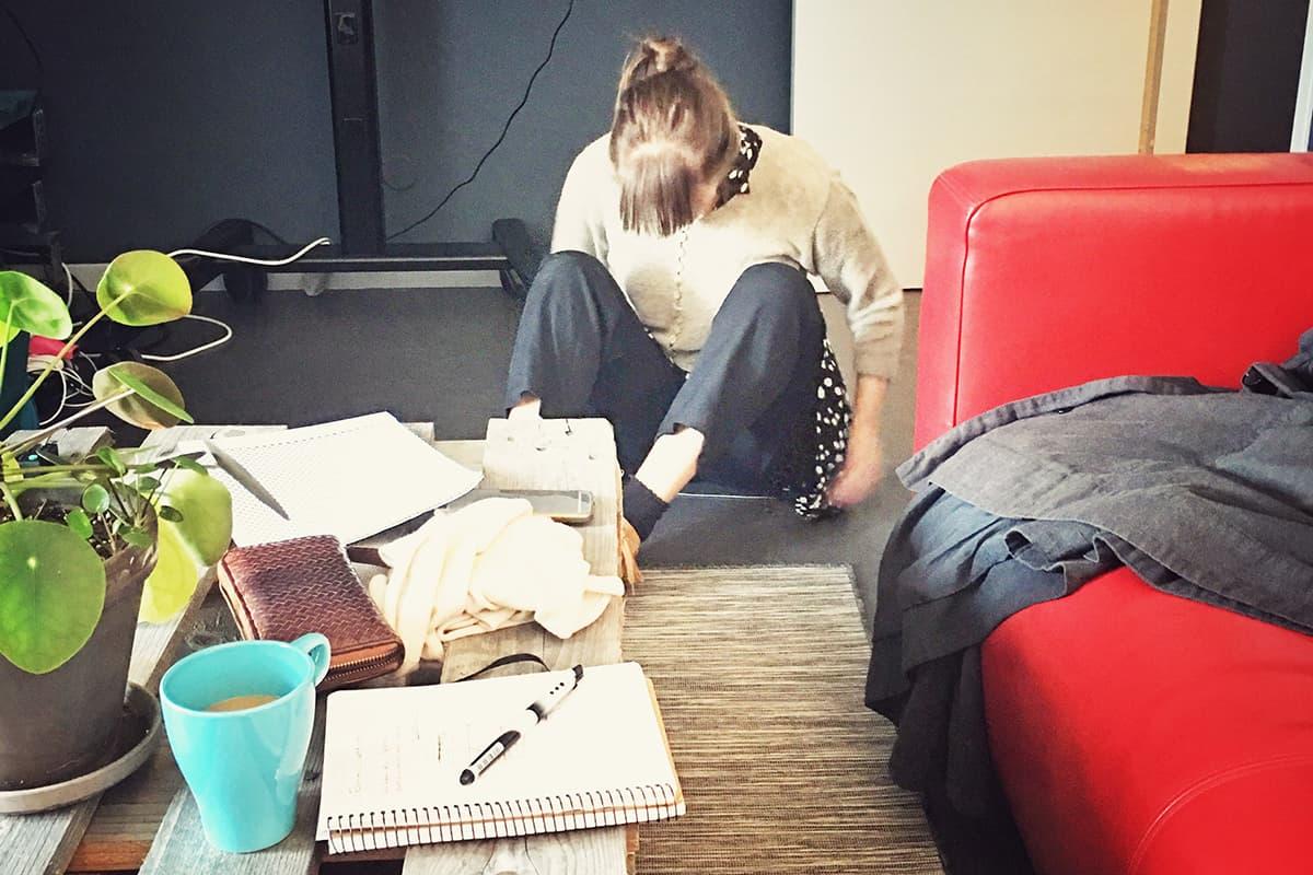 Amalia sitting on the floor testing I Heat You material